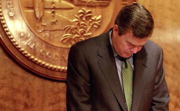 "Jeb Bush, seen here bowing his head in prayer as governor of Florida in 2000, is deeply religious. ""Twenty years ago I converted to Catholicism,"" Bush said last month. ""It was one of the smartest things I've done in my whole life."""