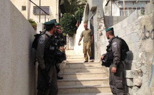 Israeli police stand near a residence in East Jerusalem where Israeli Jews have bought apartments in the predominantly Palestinian neighborhood of Silwan. The Palestinian seller said he sold the apartment to a Palestinian middleman and did not realize the