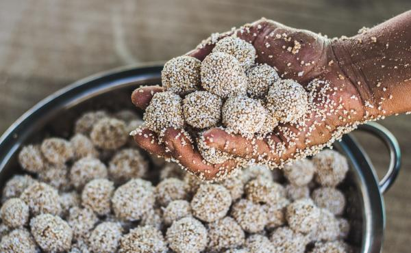Close-up of tzoallis being made during a summer nutrition workshop held by Puente a la Salud, a group based in Oaxaca, Mexico, that is helping to push an amaranth comeback. An ancient Aztec staple, tzoallis are made of amaranth and corn flour, agave honey