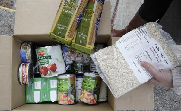 A box of food prepared at a food bank distribution in Petaluma, Calif. The state ranks near the bottom in enrolling people for food assistance. To change that, it's taking lessons from its robust Medi-Cal health insurance program, which targets much the s