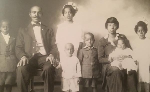 """Left to right: George Fermon (standing), Benjamin F. Fermon (seated, author's grandfather; father of children pictured), Jessie Fermon (standing, back row), Benjamin """"Bizzy"""" Fermon (front row, white romper), Harold Fermon, (grey knee-britches suit), Jessi"""