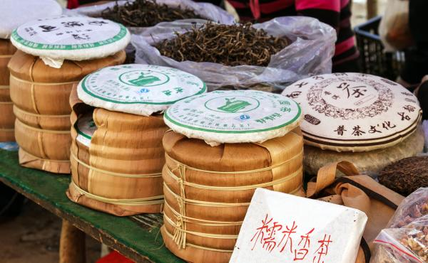 Pu'er tea is packed in bings at a market in China's Yunnan province. A cake of Pu'er continues to change as it ages, and bits of tea are chipped off in order to brew.