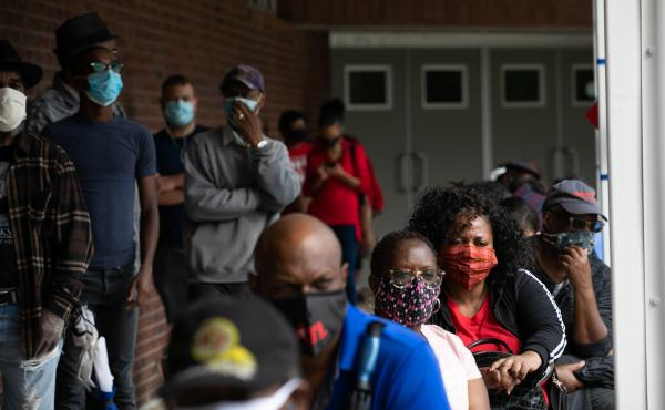 People wait in line on the first day of early voting for the 2020 general election on Oct. 12 in Atlanta.