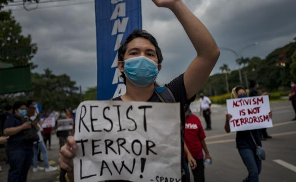 A protester wearing a face mask demonstrates against the Philippines' new anti-terrorism law on July 4, in Quezon city, Metro Manila. Earlier this month, President Rodrigo Duterte approved a law that critics say could lead to more human rights abuses.