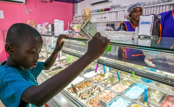 A young boy eyes his options at Nice Cream.
