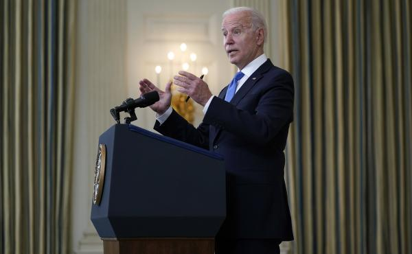 President Joe Biden takes questions from reporters as he speaks about the American Rescue Plan, in the State Dining Room of the White House, Wednesday, May 5, in Washington.
