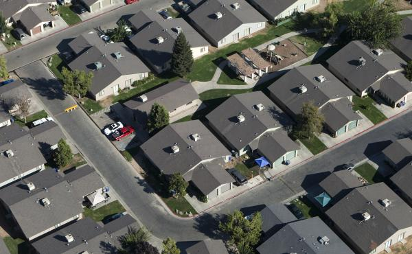 Lawmakers in California say the state's pattern of single-family zoning is boosting carbon emissions.