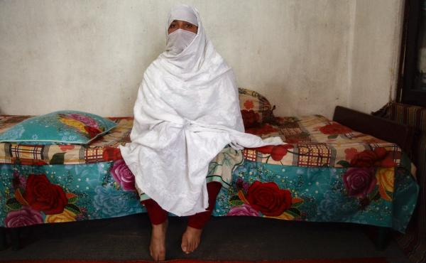 Mehnaz sits inside her home in Abbottabad, northern Pakistan. She has one son and six daughters. She has also had three abortions, fearing she would have more girls.