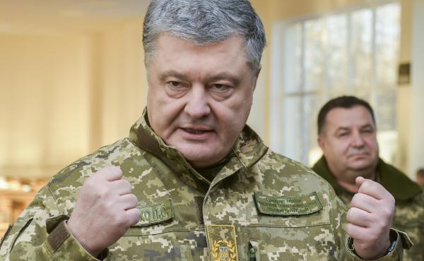 Ukrainian President Petro Poroshenko speaks to soldiers during a visit to a military base in Chernihiv region, Ukraine, on Wednesday. Russia and Ukraine traded blame after Russian border guards on Sunday opened fire on three Ukrainian navy vessels and eve