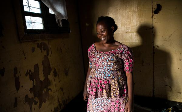 Esperance Nabintu, 42, an Ebola survivor, photographed on Aug. 15 in Goma. One of her children also contracted the disease and survived. But her husband, Rene Daniele Fataki, died from the disease. This photo was taken as friends and family gathered at he