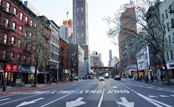 Economic ghost town: New York City's 1st Avenue was mostly deserted Saturday as New Yorkers responded to orders to stay at home.
