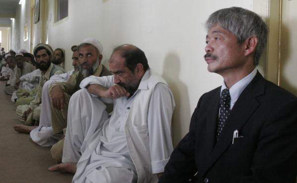 Tetsu Nakamura (right) is pictured in 2008 during a memorial service for a slain aid worker. The Japanese doctor was among six gunned down in an attack Wednesday in the eastern Afghan city of Jalalabad.