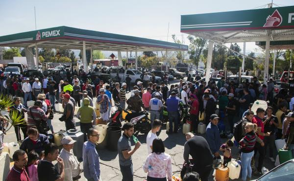People line up to buy gasoline at a gas station in Morelia, Michoacan, on Jan. 8. Michaocan is one of several Mexican states where fuel shortages have been reported.