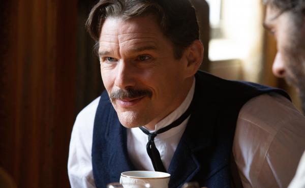 Ethan Hawke plays Serbian American inventor Nikola Tesla in the playful new biopic, Tesla.