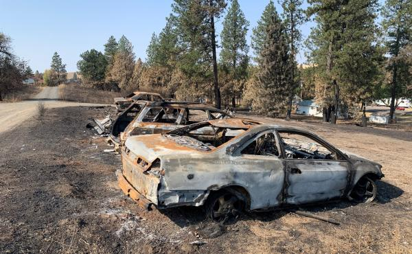 Burned cars from a wildfire that destroyed most of the eastern Washington town of Malden on Labor Day.