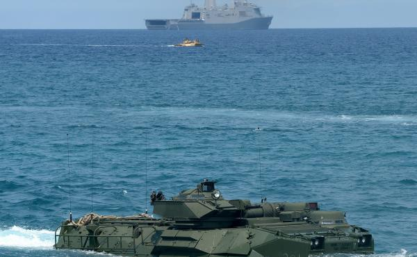 A U.S. Marine amphibious assault vehicle makes its way to shore after leaving an amphibious transport dock ship during a landing exercise on a beach at San Antonio in the Philippines' Zambales Province on April 21, 2015. The exercise was part of annual Ph