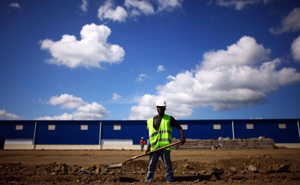 Workers prepare the foundation for a new warehouse and manufacturing facility at the Caracol Industrial Park in northern Haiti. The park, which opened last year, is still under construction.