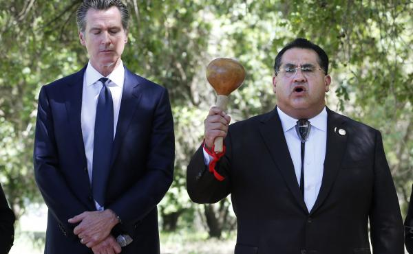 Last year, at the future site of the California Indian Heritage Center in Sacramento, Gov. Gavin Newsom, left, with Assemblyman James Ramos, formally apologized to tribal leaders across the state for the violence, mistreatment and neglect inflicted on Nat