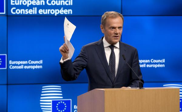 European Council President Donald Tusk holds up the document from the U.K. in Brussels on Wednesday. Tusk has received a letter from British Prime Minister Theresa May invoking Article 50 of the bloc's key treaty, the formal start of exit negotiations.
