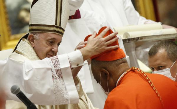 Archbishop Wilton Gregory of Washington, D.C., becomes a cardinal during a ceremony Saturday known as a consistory in St. Peter's Basilica at the Vatican. Pope Francis cautioned new cardinals never to lose their connection to the people.