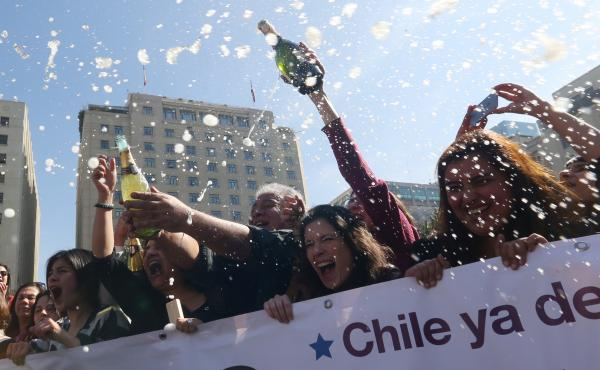 Activists celebrate outside the Constitutional Court in Santiago, Chile, on Monday. The court approved a measure to ease the country's strict abortion ban by decriminalizing the procedure in certain cases.