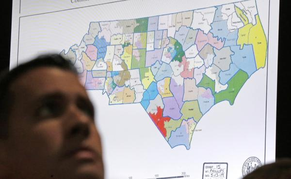 A North Carolina map is shown in Wake County Superior Court during a 2019 redistricting trial. Republicans and Democrats are preparing for a battle of state legislative supremacy that could have a big effect on political power for the next decade.
