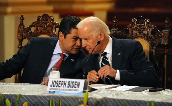 Honduran President Juan Orlando Hernández (left) speaks with then-Vice President Biden during a news conference in Guatemala City on March 2, 2015. Leaders from Guatemala, El Salvador and Honduras were meeting with Biden for two days of talks about child