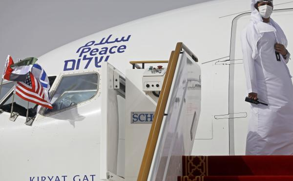 An official stands at the door of an Israeli El Al airliner after it landed in Abu Dhabi, United Arab Emirates, on Monday after flying in from Tel Aviv.
