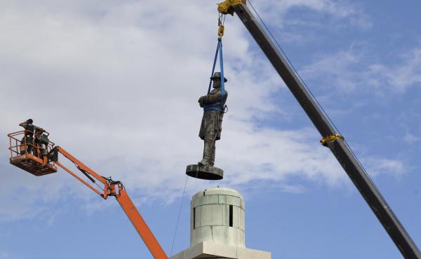 A statue of Confederate Gen. Robert E. Lee is removed Friday from Lee Circle in New Orleans. Lee's was the last of four monuments to Confederate-era figures to be removed under a 2015 City Council vote on a proposal by Mayor Mitch Landrieu.