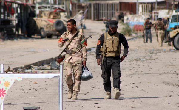 Iraqi soldiers walk in Jurf al-Sakhr, south of the capital Baghdad, on Monday after Iraqi military forces retook the area from Islamic State militants. Iraqi forces, supported by U.S. airstrikes, have made limited gains in recent months, but critics are q