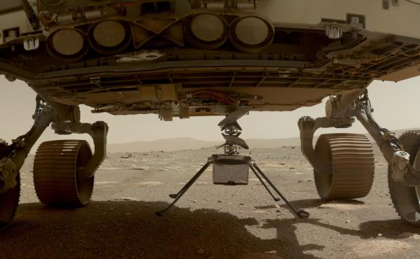 NASA's Ingenuity helicopter with all four of its legs deployed before dropping from the belly of the Perseverance rover on March 30, 2021.