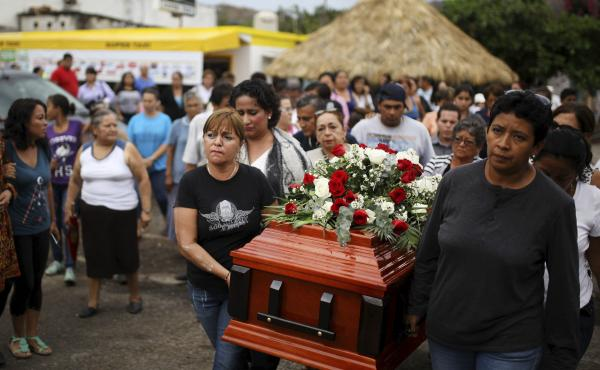 Members of a search group carry the coffin of Pedro Huesca as they walk to a cemetery in Veracruz, Mexico, on March 8. Huesca, a police detective, disappeared in 2013 and was found in a mass grave. His remains were among more than 250 skulls found over th