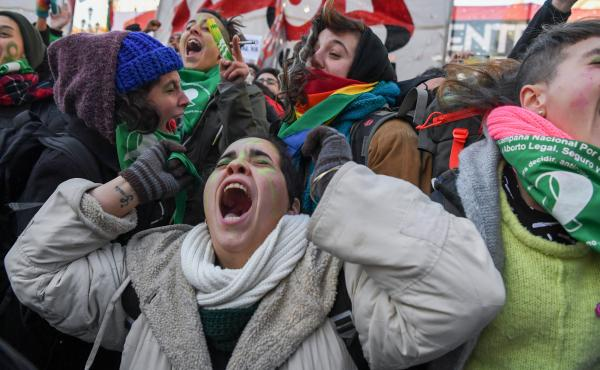 Abortion rights activists celebrate Thurdsay outside the Argentine Congress in Buenos Aires, shortly after lawmakers in the country's lower chamber passed a bill legalizing abortion. The bill's chances look uncertain in the upper chamber, but that did lit