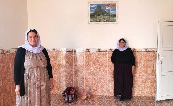 Nofa Khudeda (left) and a neighbor in the village of Tel Qasab on the day Khudeda and her husband returned after six years in a camp for displaced Yazidis. Khudeda and her husband, Ali Edo, repaired and renovated the house, which had been looted by ISIS f