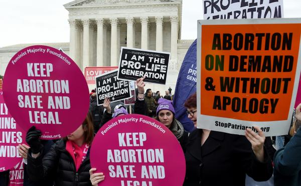 Activists on opposite sides of the abortion debate demonstrate in front of the Supreme Court during the annual anti-abortion-rights event known as the March for Life, on Jan. 24 in Washington, D.C.