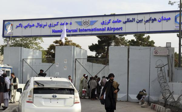 Taliban fighters stand guard in front of the Hamid Karzai International Airport after the U.S. withdrawal in Kabul, Afghanistan.