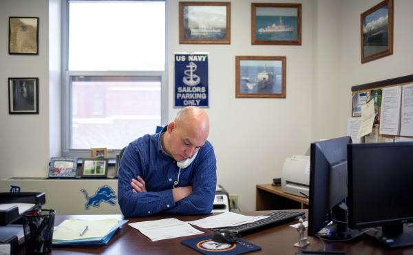 Grant County VSO Bob Kelley makes calls in his office at the Grant County Government Building in Marion, Ind.