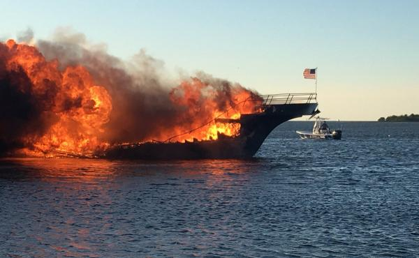 Flames engulf a boat Sunday in the Tampa Bay area. Officials said one person died after the boat ferrying patrons to a casino ship caught fire near shore, forcing dozens of passengers and crew to jump overboard.