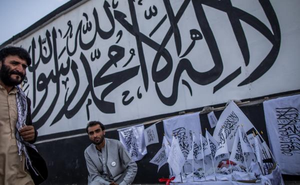 A man sells Taliban flags imprinted with the Muslim creed in Kabul, Afghanistan, on Sept. 24.