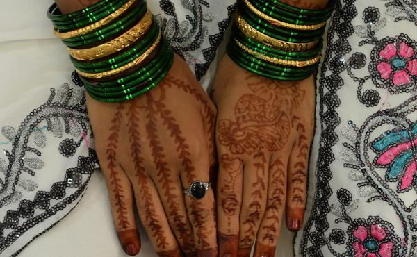 The hands of a mehendi (henna)-decorated bride is pictured in Mumbai in 2014. India's Supreme Court on Thursday struck down a law that makes adultery a crime.