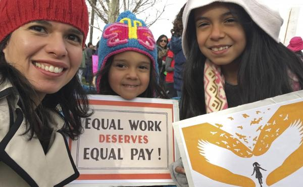 A federal court has sided with Aileen Rizo, who filed suit after realizing her male counterparts were being paid more. The ruling overrules a previous interpretation of the 1963 Equal Pay Act. Rizo is seen here with her daughters in a photo she provided t