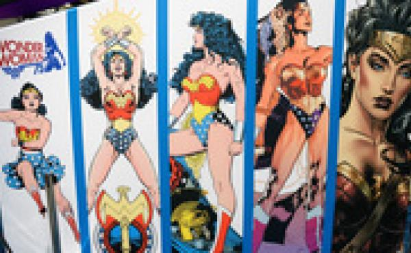 """As of Friday, Wonder Woman will no longer be an honorary U.N. ambassador. A petition protesting her appointment called her """"a large-breasted, white woman of impossible proportions."""" Above, a display at Comic-Con International 2016 shows the evolution of h"""