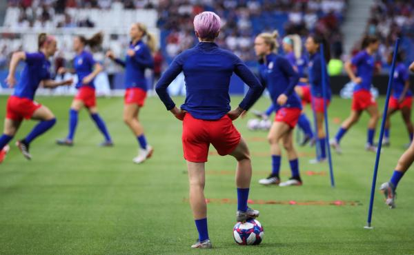 The Netherlands are the last team standing between the United States and its fourth Women's World Cup. Here, U.S. forward Megan Rapinoe watches her teammates warm up before Tuesday's 2-1 semifinal win over England.