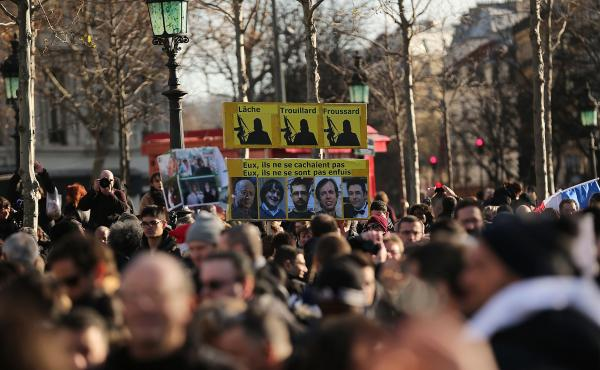 Demonstrators gather Sunday in Place de la Republique prior to a mass unity rally in Paris following the recent terrorist attack.
