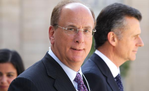 """BlackRock Chairman and CEO Larry Fink, seen here in Paris in July, wrote in his annual letter to CEOs that climate change will soon cause """"a significant reallocation of capital."""""""