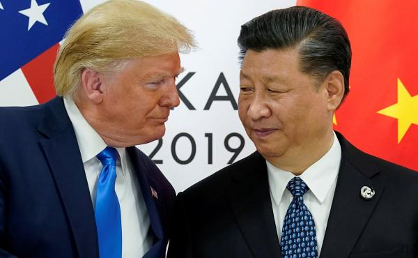 """""""China supports the idea of a comprehensive review of the global response to COVID-19, after it is brought under control,"""" says President Xi Jinping, seen here with President Trump last summer."""