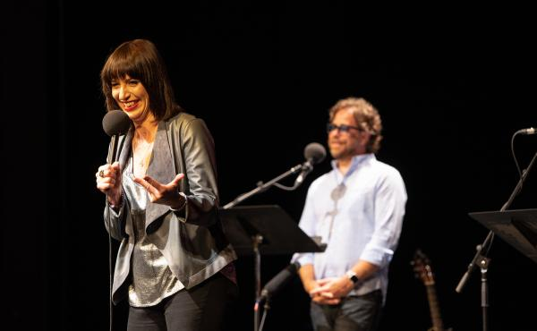 Ophira Eisenberg performs on stage with Jonathan Coulton on Ask Me Another at the Majestic Theatre in Dallas, Texas.