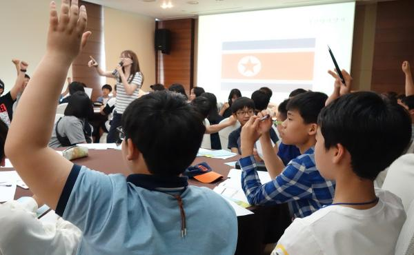 The eighth and ninth graders at a recent Unification Leader Camp in Jeju, South Korea, answer questions about their knowledge of their neighbors to the North.