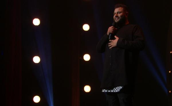 """Comedian Mo Amer, seen here in his Netflix special The Vagabond, says that stand-up has been a significant part of his """"coping process"""" with an itinerant childhood."""