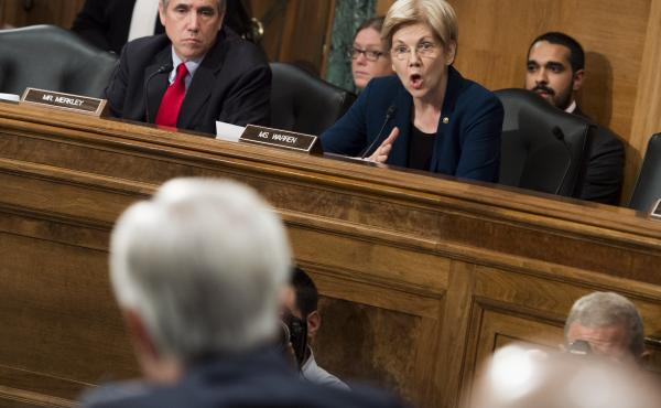 Sen. Elizabeth Warren questions John Stumpf, chairman and CEO of Wells Fargo, about the unauthorized opening of customer accounts by Wells Fargo during a Senate Banking Committee hearing Tuesday.